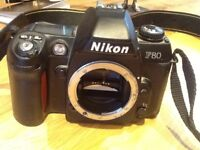 SLR NIKON F80 CAMERA BODY. PLUS 28-80MM LENS AND ZOOM LENS PACKAGE