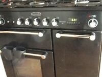 900 Duel fuel black Rangecooker 2 electric ovens, 5 gas plates. Timer, automatic timer,