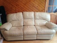 Cream three and two seater reclining leather sofa