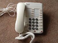 A BT OFF-WHITE CORDED LANDLINE HOUSE PHONE WITH REDIAL, SECRECY, RECALL, AMPLIFY, MONITOR
