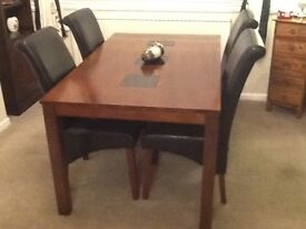 Table & Chairs, display cabinet and tall wall unit all dark wood.