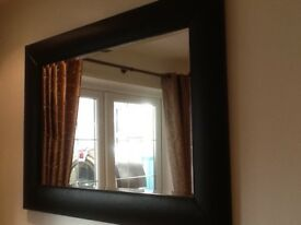 Large mirror with brown faux leather surround