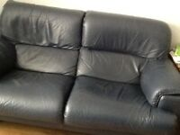 Navy blue leather sofa and footstool