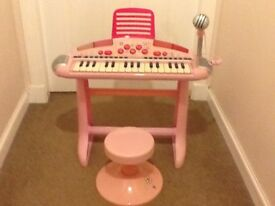ELC girls pink piano, micro phone and stool.