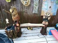 Chainsaw carvings (bear. Owl water bench)