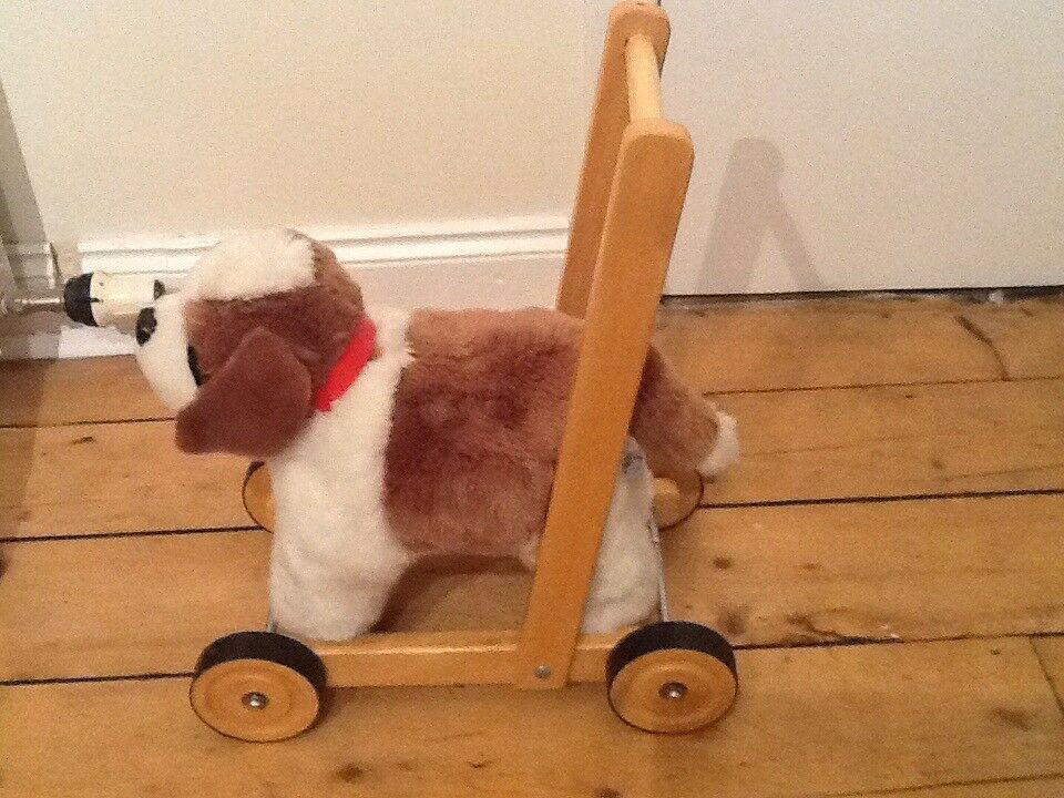 Toddler toy dog on wheels