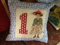 Baby girl's Cushion with applique 1 on with a doll