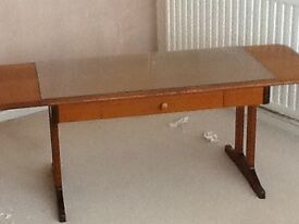 Coffee table teak with glass top. extendening and small drawer.