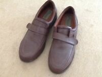 Pair of men's shoes for sale.