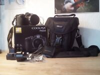 Nikon CoolPix P610 + bag + cleaning set