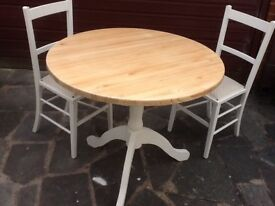 Shabby chic table with two upholstered antique chairs