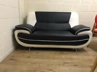 Black and White Two Piece Synthetic Leather Sofa Set Great condition