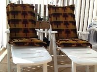 Reclining white garden chairs