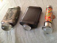 three vintage bullseye torches