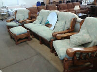 wood framed 3 seater sofa with 2 armchairs and pouffe