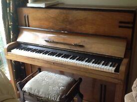 Upright piano - £35
