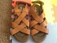 Men's Brown leather Clarks sandals with heal strap size 8 and a half.