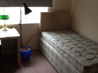 Large furnished room in detached house for professional person. All bills included.