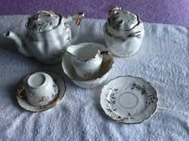 Vintage tea set in white with gold decoration