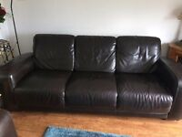 2 x three seater leather settees / sofas and a footstool ;