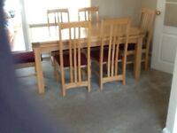 Extendable Light Oak dining table and six chairs