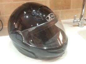 Black X-lite motorcycle helmet .