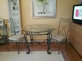 Round glass table + 4 matching chairs