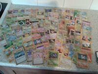 Approx 100 pokemon cards and a pile of what I think are codes