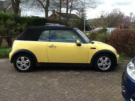 yellow mini cooper convertible 1600