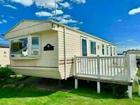 Cheap static caravan for sale , sited in essex includes decking