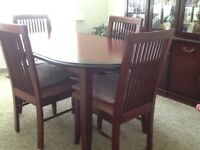 Dark wood dining table and 4 chairs.