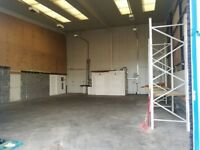 2000 sqft warehouse with free parking outside.
