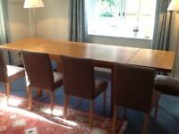 Solid oak dining table with 2 leaves and 6 upholstered chairs