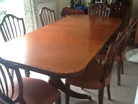 Reproduction mahogany veneered dining table and 8 chairs