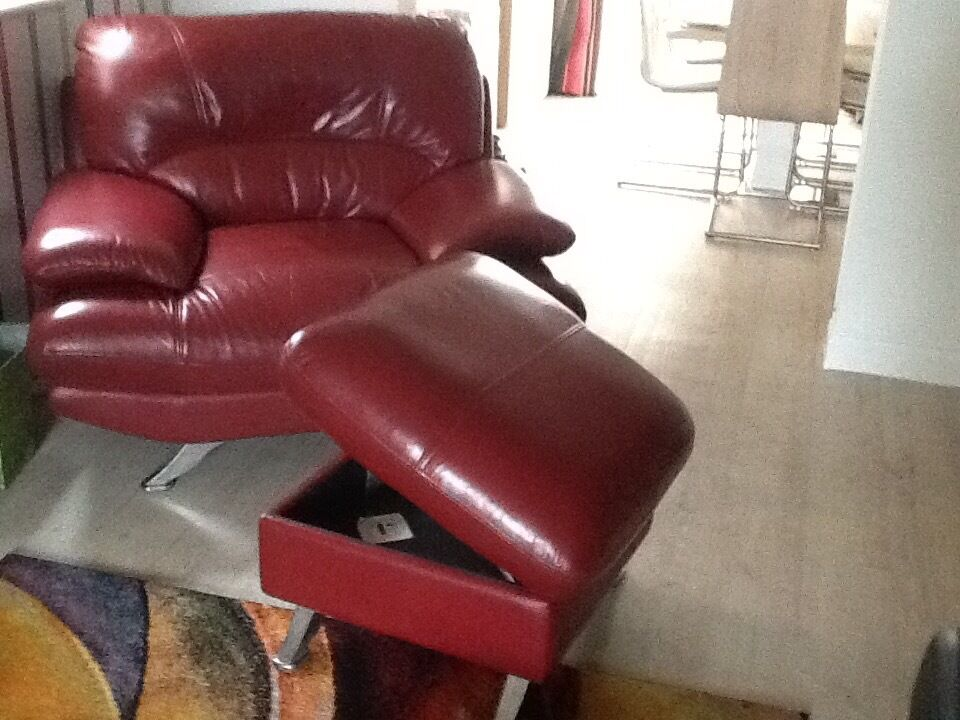 Modern leather chair with matching foot stall with storagein Gosport, HampshireGumtree - Comfortable Modern burgundy real quality leather chair with matching foot stall in very good condition with chrome feet. The foot stall opens to accommodate a storage area ideal for DVDs. looking for a quality piece of furniture at a great price this...