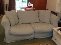 2 seater sofa with 2 sets of loose covers