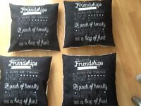 Four cushions black on one side and white on the other