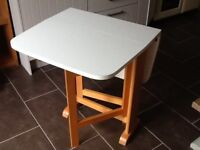 Wooden solid gate leg table.