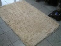 £30- cream 100% wool pile shaggy deep,thick rug 152cm x 105cm from NEXT -vacuumed and cleaned