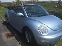 VW Beetle convertible 2003. Baby Blue complete with flower! MOT. FSH .Beautiful well looked after.