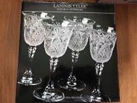 Set of 4 crystal wine glasses brand new