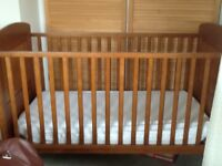 Wooden cot, easy assembled, with mattress and sheet.
