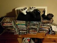 PS3 SLIM WITH 87 GAMES INCLUDING GTA 5, THE WOLF AMONG US, AND 4 CONTROLLERS!