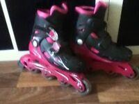 Raptor Pink/Black multi size roller boots