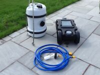 Large water barrel with ball valve and hose for serviced pitches plus waste container