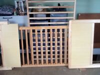 Cot bed with bedding.