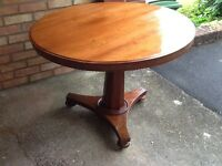 Antique circular tripod table