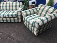 green checked fabric two seater sofa with matching chair.delivery possible