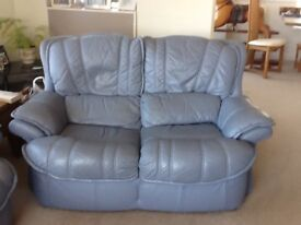 Very tidy blue leather 3 and 2 seater sofas no rips or tears with safety fire label