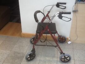 Mobility aide walker with lever brakes,padded seat,is foldable-several ex showroom models available